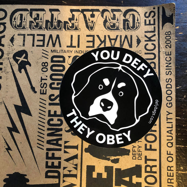 YOU DEFY, THEY OBEY | The Otis Sticker | White on Black