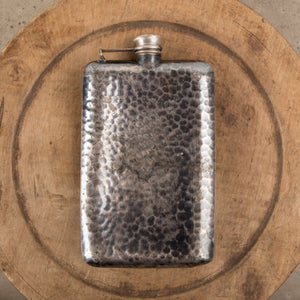 A hammered tin flask