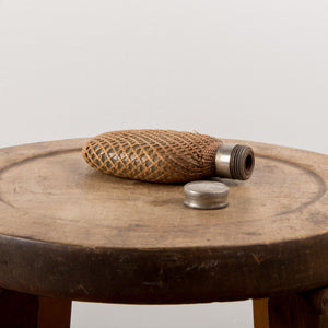 Vintage small flask wrapped in wicker