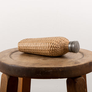 1920 European wicker woven covered glass bottle
