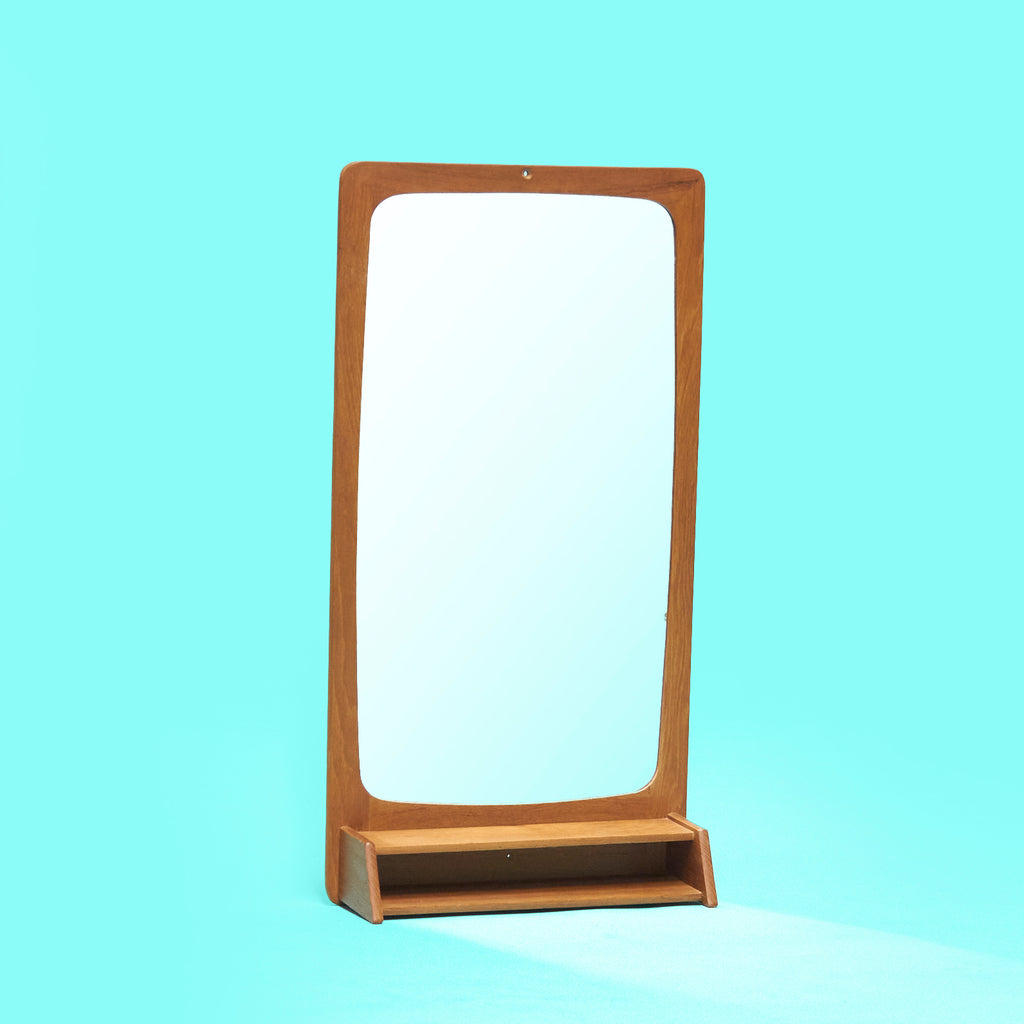 Mid-century Danish mirror with small shelf in teak