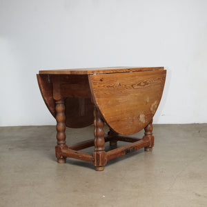 A Danish 18th century Baroque pine drop leaf table