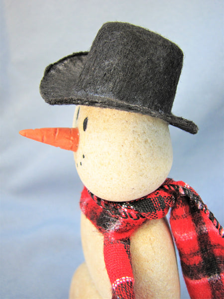 Snowman made of Stacked Stone - With Black Hat and Plaid Scarf