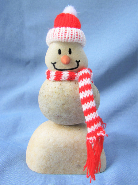 Snowman with Red Santa Hat, Made of Stacked Stone