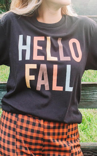 woman wearing fall-inspired graphic tee in modern boho color palette