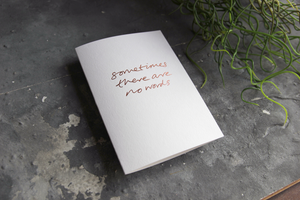 this luxury sage green colour paper greetings card is hand foiled with the phrase 'Wish I Knew What To Say'