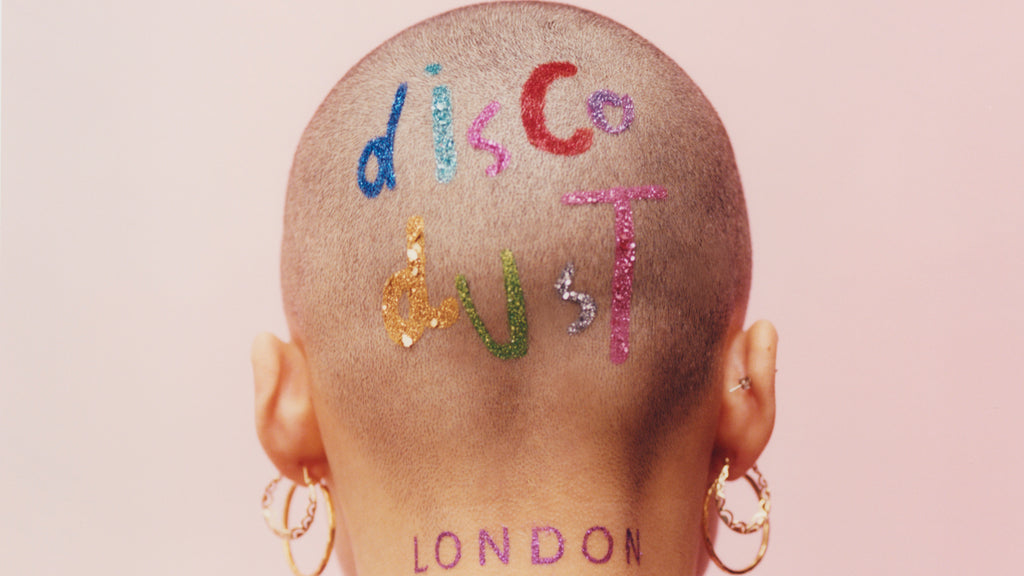 disco dust gliiet london on the back of a shaved head