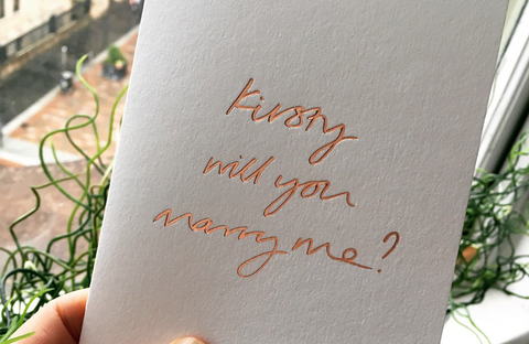 personalised proposal card saying Kirsty will you marry me?