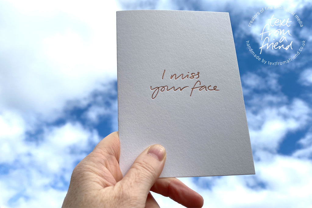 hand foiled card form text from a friend says 'I Miss Your Face'