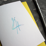 A fourth birthday card with a hand drawn number four hand pressed in holographic foil on the front