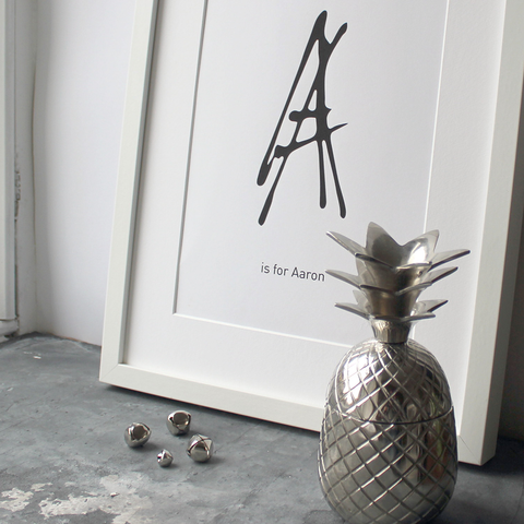 This personalised children's initial print is a unique hand drawn typography design in black on white paper.