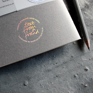 a handmade luxury notebook that's hand foiled with a holographic foil