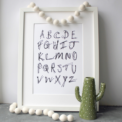 This children's alphabet print is a unique hand drawn typography design in black letters on white paper.