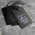 "Luxury black gift tags with waxed cotton thread have ""If You Don't Like It I Do' handprinted in handwritten silver foil."