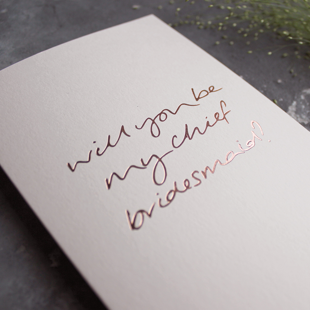 This luxury card is hand foiled in rose gold asking Will You Be My Chief Bridesmaid? on the front on blush paper