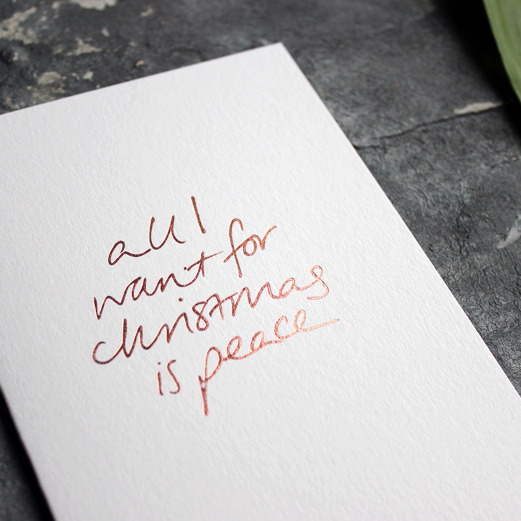 Christmas Card with hand written foil block message saying all I want for christmas is peace