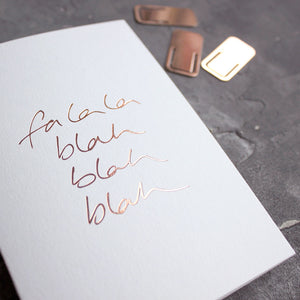 This rose gold hand foiled luxury white card says Fa La La Blah Blah Blah on the front in handwriting from Text From A Friend