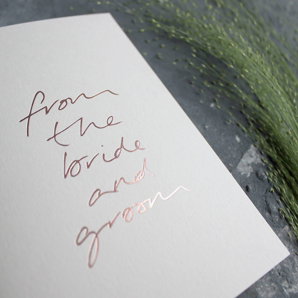 This hand foiled thank you card says 'From The Bride And Groom' on the front on blush paper