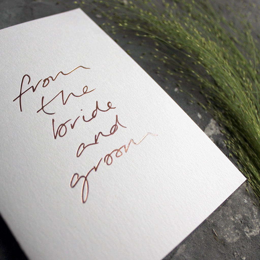 This hand foiled thank you card says 'From The Bride And Groom' on the front on white paper