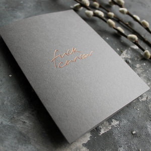 This luxury hand foiled card says 'Fuck Cancer' on the front on grey paper