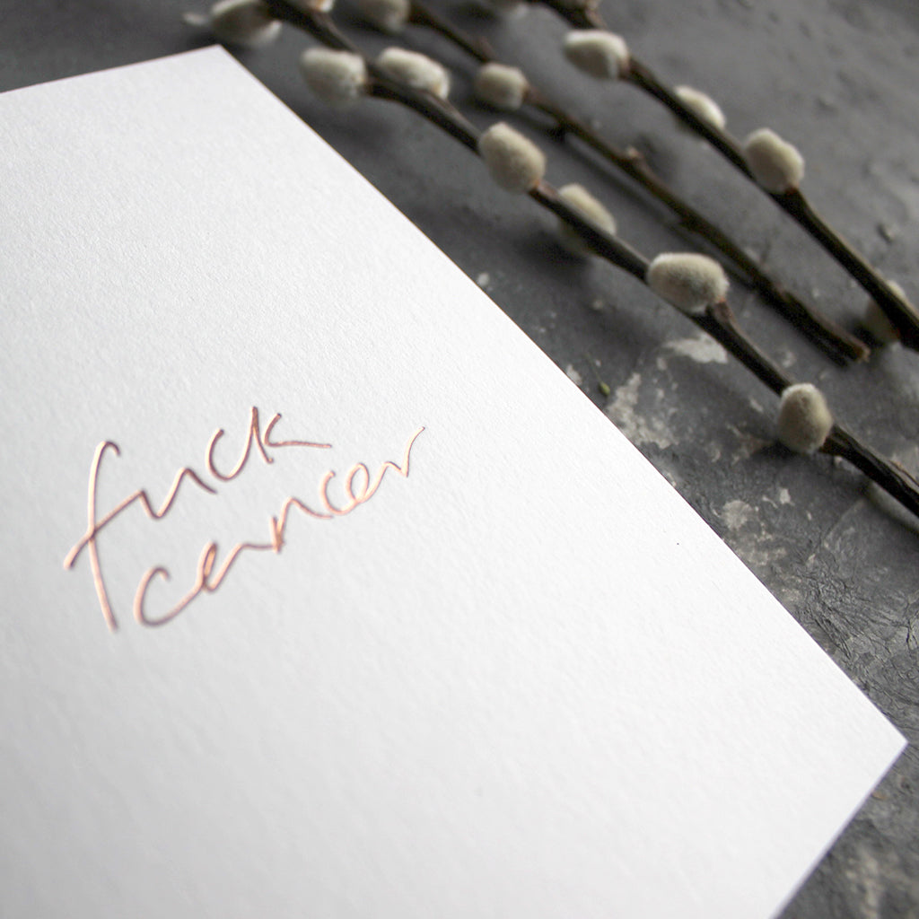 This luxury hand foiled card says 'Fuck Cancer' on the front on white paper