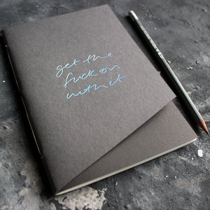 a grey handmade luxury notebook that's hand foiled with the message Get The Fuck On With It in holographic foil