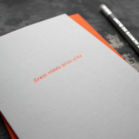 The front of the grey card says Great Minds Drink Alike and is stamped in neon orange foil