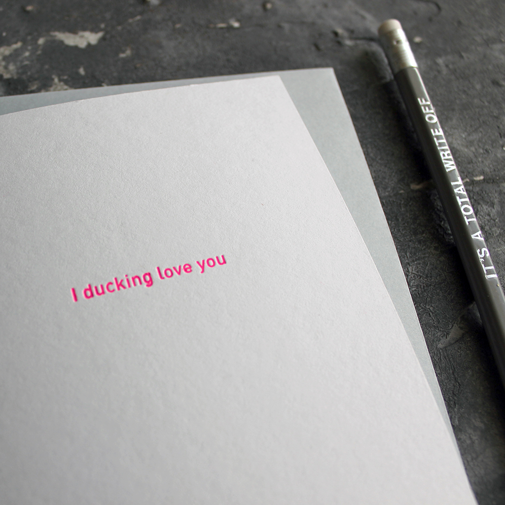 The front of the grey card says I Ducking Love You and is stamped in pink neon foil