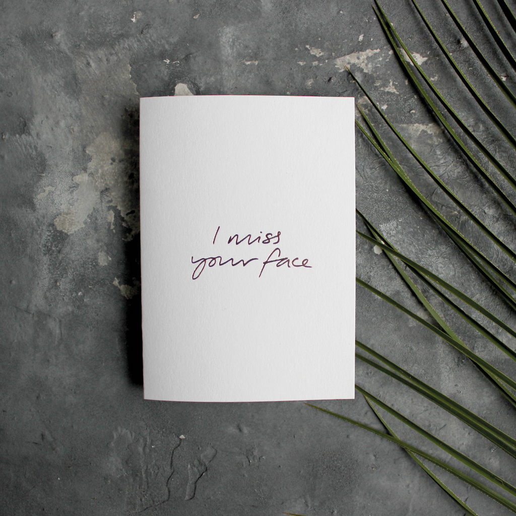 The front of this luxury card says I Miss Your Face, handwritten and hand foiled in rose gold foil