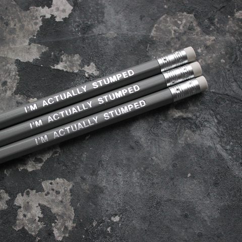 Grey pencils with a silver foil blocked message that says I'm Actually Stumped