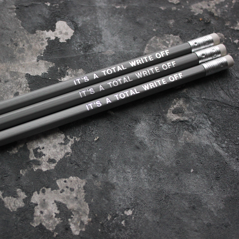 Grey pencils with a silver foil blocked message that says It's A Total Write Off