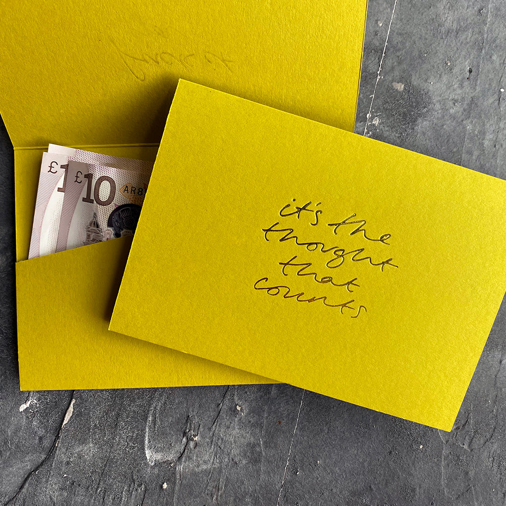 this hand foiled lime coloured cash card says 'It's The Thought That Counts' on the front