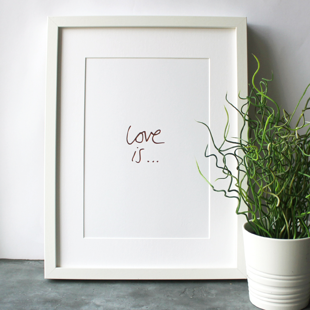 this handwritten Love Is... A4 print is hand pressed in rose gold foil and comes unframed