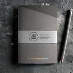 a grey handmade luxury notebook that's hand foiled with the message Never Not Procrastinating