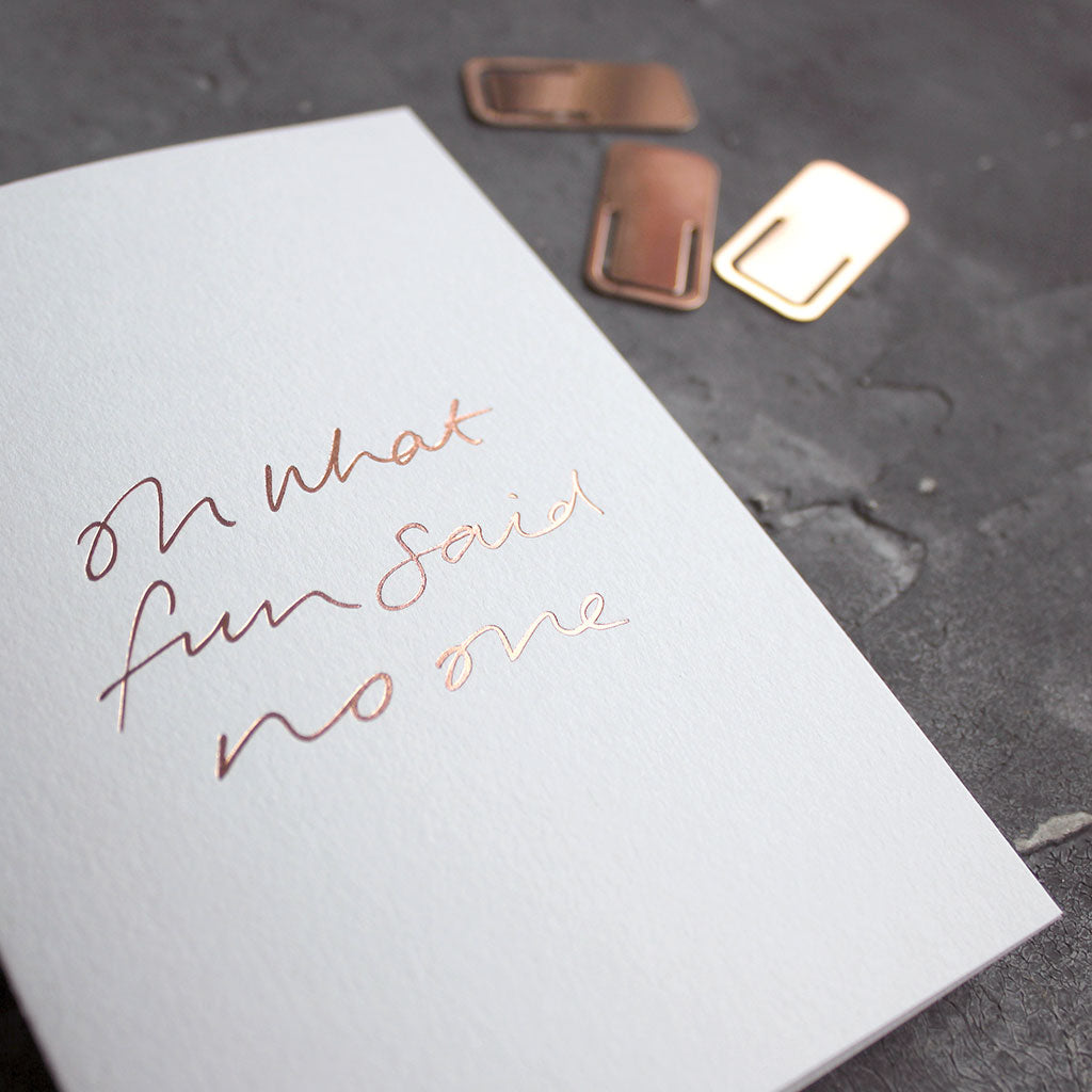This rose gold hand foiled luxury white card says Oh What Fun Said No One on the front in handwriting from Text From A Friend