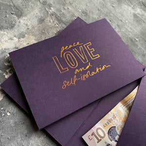 this hand foiled smoke purple coloured cash card says 'Peace Love and Self-Isolation' on the front in rose gold foil