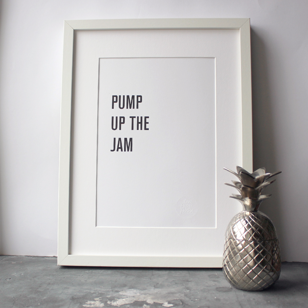 The lyrics 'Pump up the jam' are typographically designed and digitally printed in this frame