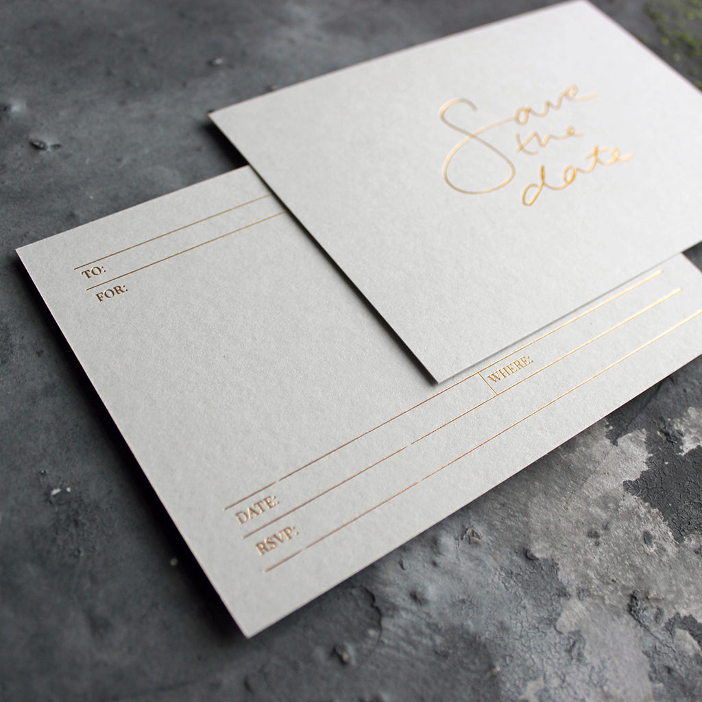 a luxury hand foiled pale grey save the date invitation that's blank on the back for your details