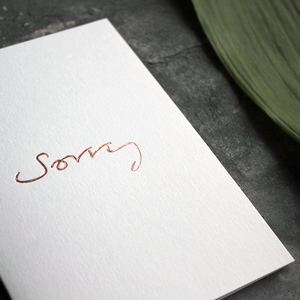This one little word 'Sorry' is on the front, handwritten and hand foiled in rose gold