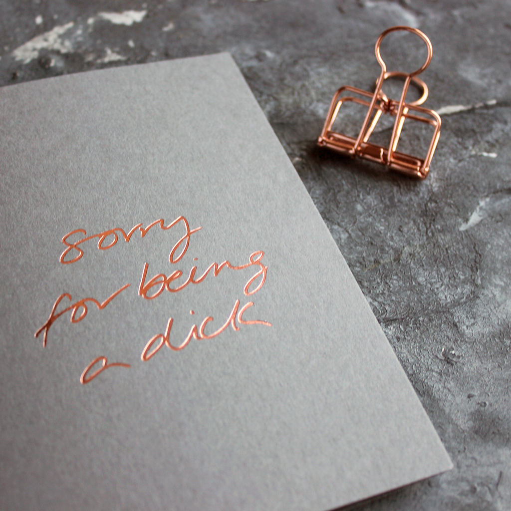 Sorry For Being A Dick grey luxury card is hand foiled in rose gold on the front