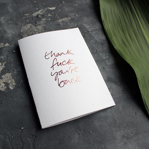 a luxury card says Thank Fuck You're Back card in Rose Gold foil on the front