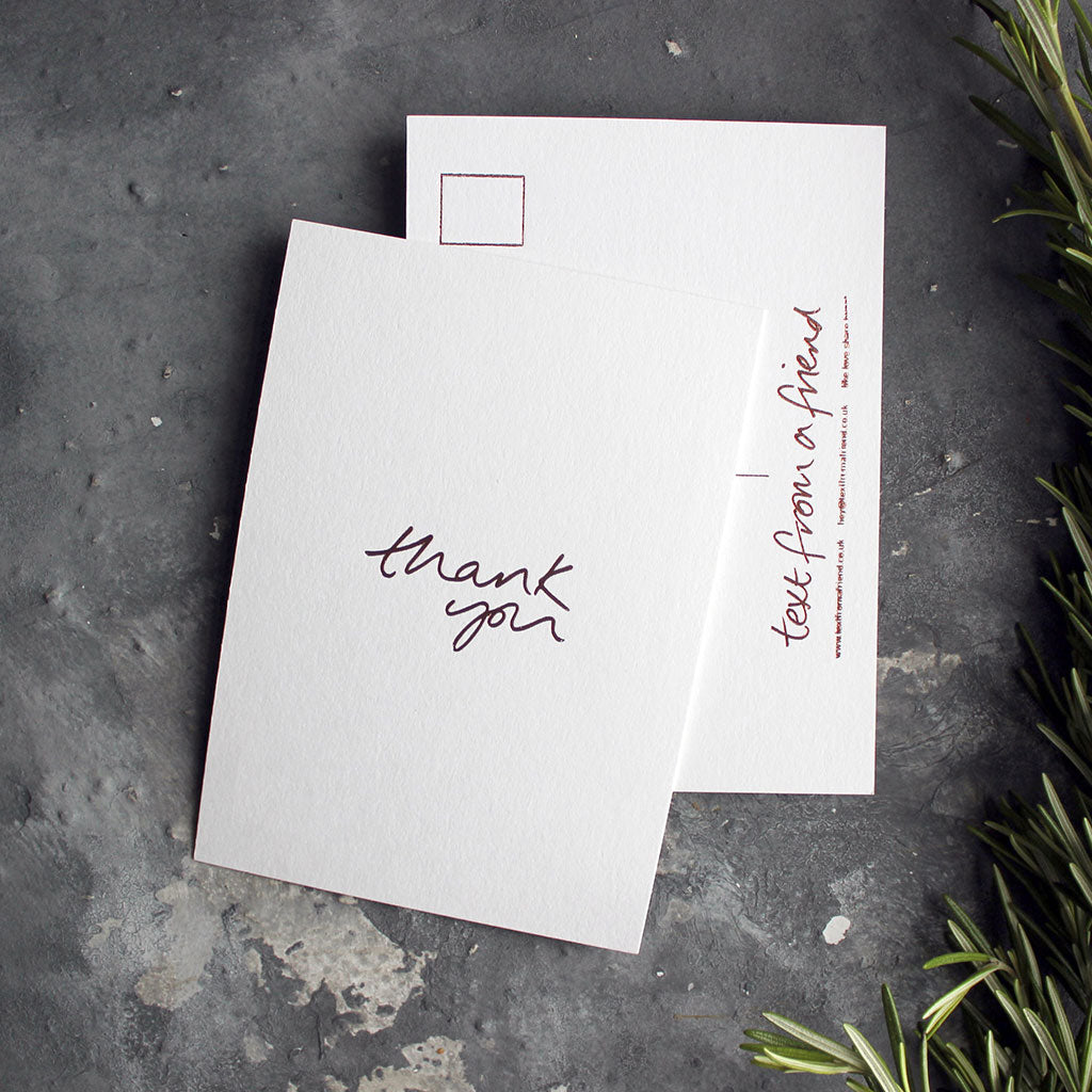 a luxury wedding card that's handwritten with a rose gold foil message saying Thank You