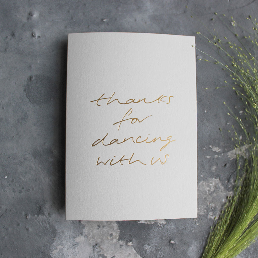 This pale grey luxury card is hand foiled and says 'thanks for dancing with us' on the front