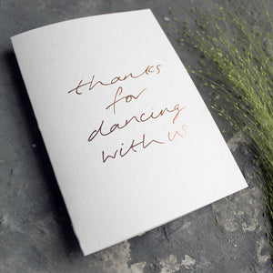 This white luxury card is hand foiled and says 'thanks for dancing with us' on the front