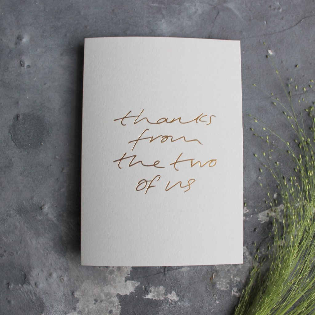 "This luxury thank you card is hand foiled on the front and says ""thanks from the two of us"" on pale grey card"