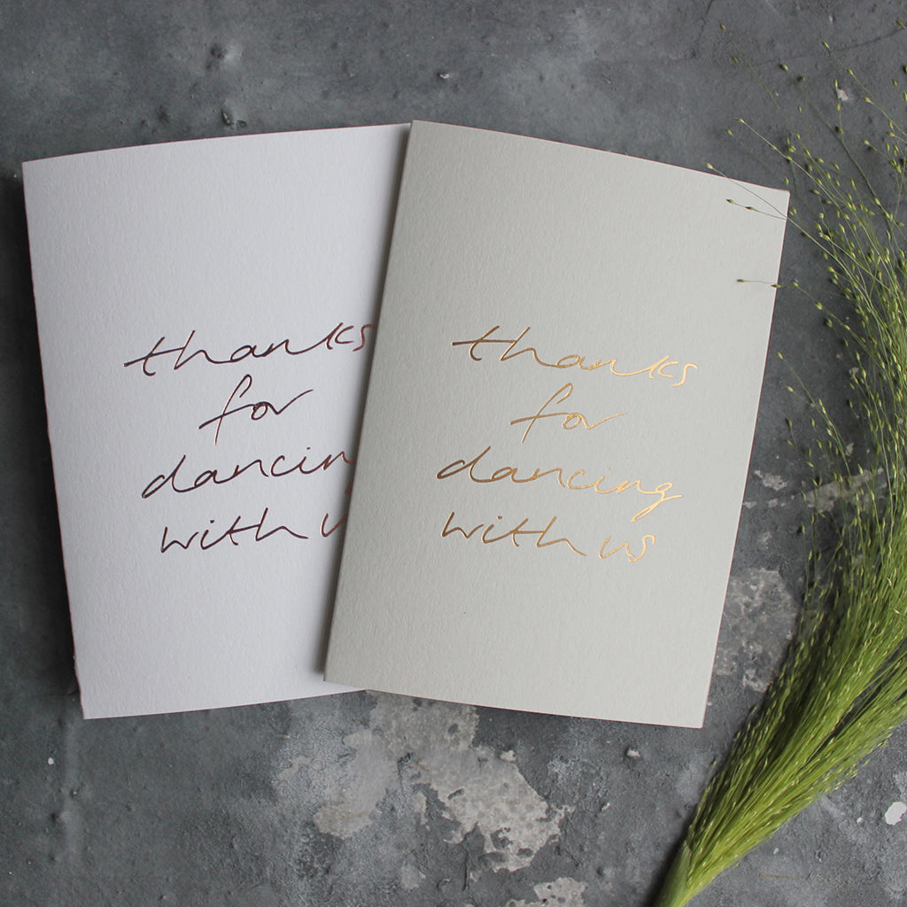 This pale grey or white luxury card is hand foiled and says 'thanks for dancing with us' on the front