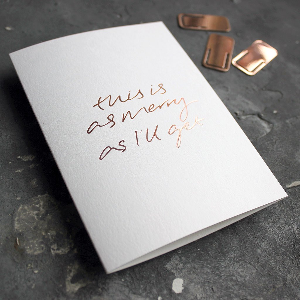 This rose gold hand foiled luxury white card says This Is As Merry As I'll Get on the front in handwriting from Text From A Friend