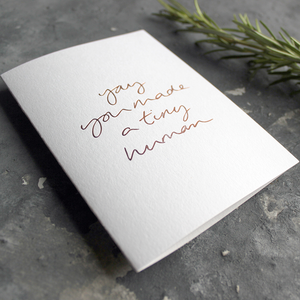 The front of the card declares Yay You Made A Tiny Human hand foiled in Rose Gold