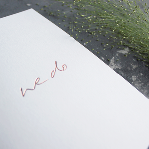 This hand foiled acceptance card says 'We Do' on white luxury paper