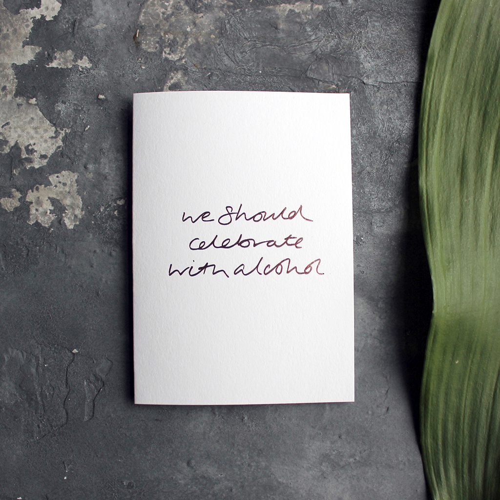 this rose gold hand foiled luxury card is printed with 'We Should Celebrate With Alcohol' on the front